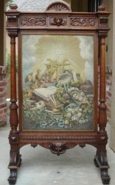 """Antique """"Renaissance Revival"""" fire screen from France. Dating from 1875-1880, it has a large, lavishly carved oak frame surrounding a   tapestry panel."""