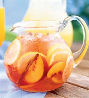Love this pitcher filled with peaches, citrus and cinnamon.  White Zinfandel Sangria : Bon Appetit