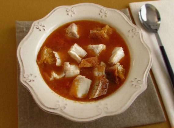 Croaker soup - Food From Portugal. Delicious soup confectioned with croaker, tomato, olive oil, onion and garlics, wrapped with bread pieces.http://www.foodfromportugal.com/recipe/croaker-soup/