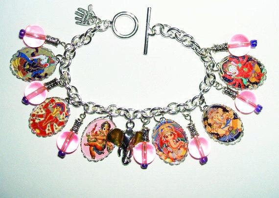 GANESH CHARM BRACELET Altered Art Hindu Divine Ganesha by artalot. $36.99 USD, via Etsy.
