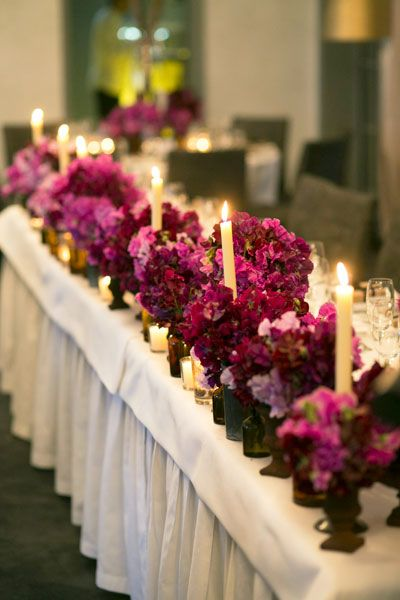 Sweet Peas In Burgundy And Purple Decorated The Tables.