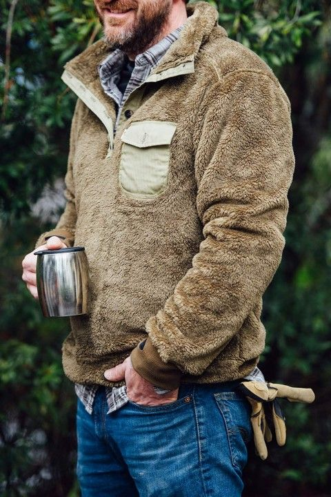 Men's fleece pullover by Buffalo Jackson Trading Co. Just right for fall tailgates and camping trips. Button-up placket, stand up collar, ribbed cuffs with thumb holes. Also available in Gunmetal. Shown here in Birchwood.
