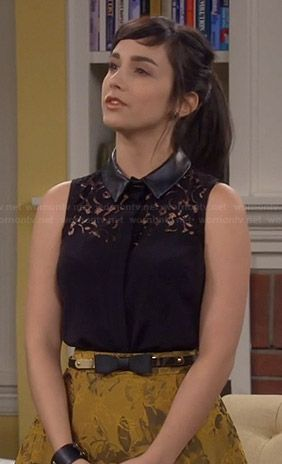 Mandy's black lace top with leather collar and gold skirt on Last Man Standing.  Outfit Details: http://wornontv.net/38566/ #LastManStanding