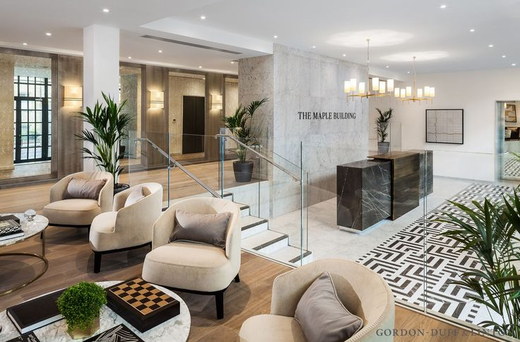 Reception area of the Maple Building. Bespoke Carrara and grey marquina marble floor tiles. Bespoke grey marquina reception desk with bronze wrap detail. Mezzanine area with B&B Italia seats and marble coffee tables. #GDLBespoke