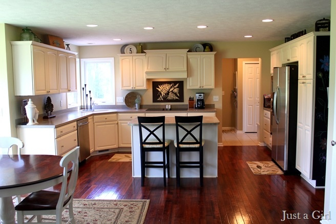Kitchen with white cabinets & cherry wood floors