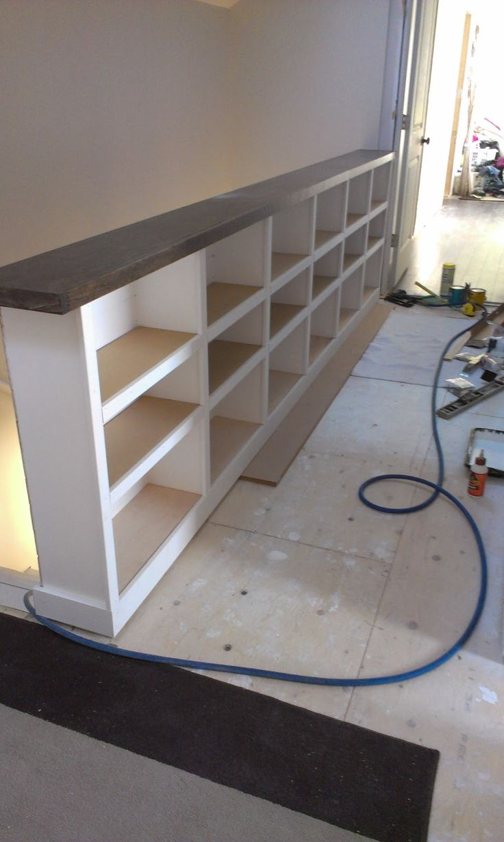 I'm going to suggest a bookcase / storage unit like this to replace the rickety railing at my parents' new (split level) townhouse.