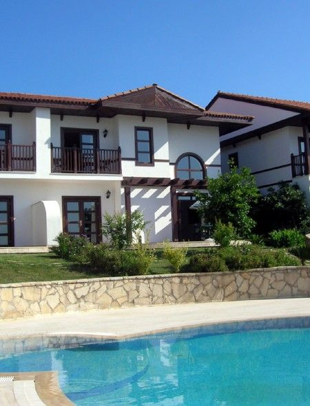 Traditional Semi Detached Villa -  This two bedroom villa is located in the lovely area of Tasaqil between Belek and Side. Situated on a lovely family friendly complex with a communal swimming pool, sun bathing terrace and pool side bar. The villa is furnished and ready to move into. Price: £45,950