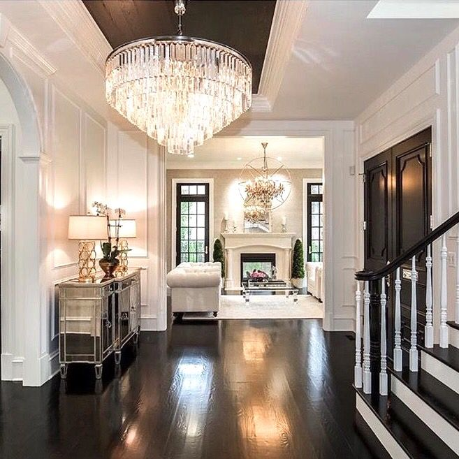 Don't like the chandelier, but love the paneling and the floors! Would look good in a French provincial style house.