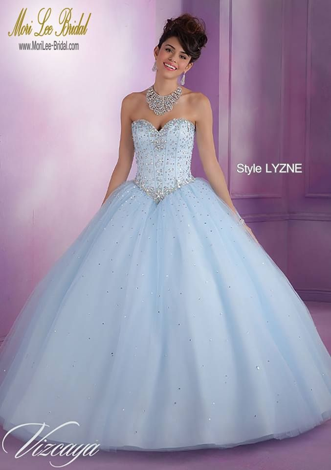 Style LYZNE Tulle Quinceanera Gown with Beading Bolero Jacket. Corset Tie Back. Colors Available: Light Blue, Aqua, Pucker Up Pink, White. Sizes Available: 0-24.