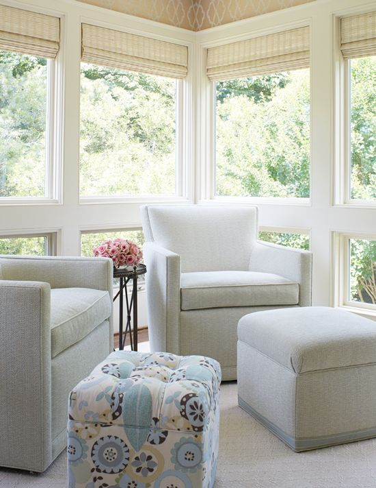 Sunroom Features A Pair Of Gray Velvet Chairs Paired With A Gray