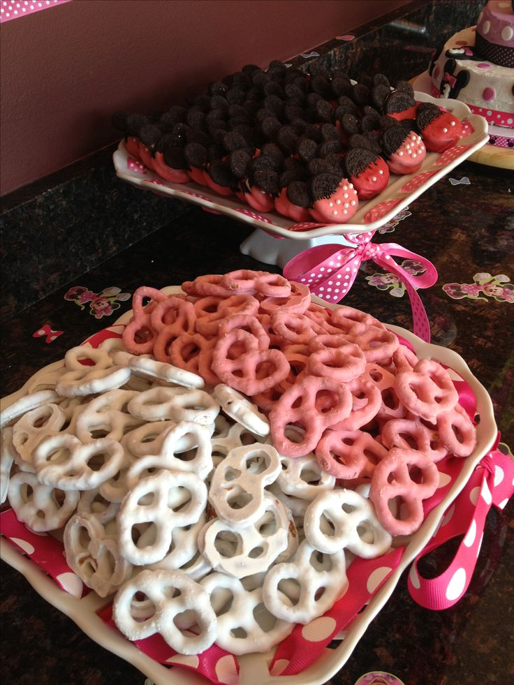 Minnie Mouse party food - pretzels cleverly iced in pink & white to look like mouse ears!