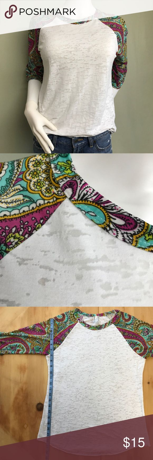 Giddy Up Glamour 3/4 Sleeve Pink & White Shirt Like new condition. Paisley print sleeves and collar in pink, teal, white, lime green, and goldenrod. The white shirt area has sheer spots so layering is needed. No holes, rips, or stains.  Approximate Measurements Laying Flat: (See Photos)  •Pet & Smoke Free Home •No Trades •BUNDLE DISCOUNT Feel free to make offer or ask questions!! Thanks for visiting my closet!! Giddy Up Girl Tops