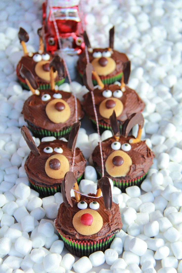 Adorable Chocolate Reindeer Cupcakes..Presentation Flying through a Mini Marshmallow Cloud..Adorable - Half Baked Harvest