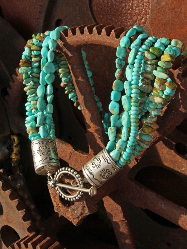 Jewelry Photography: The color and texture of the rusty metal gears are a perfect background for the turquoise.