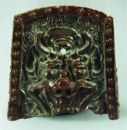 """Roof Tile with Beast Design.  Unified Silla period, 8-9th century. 28.2 cm high.  """"This type of a roof tile is called as 'a roof tile with goblin design' or 'a roof tile with dragon design.' It was usually installed at the end of the ridge of the roof..... excavated from Anapji, an artificial pond that was built in 674 and attached to the east palace where a Silla crown prince stayed."""" National Museum of Korea."""