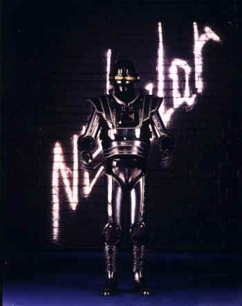 Andy Sinclair as his Nebular 1 Robot character