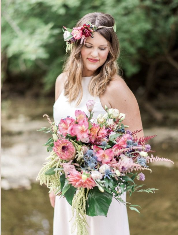 A mix of tropicals and garden flowers for a beautiful bridal bouquet. Monstera leaves, alstroemeria, protea, astilbe, eryngium, lisianthus. Engagement photo shoot. Flower crown.