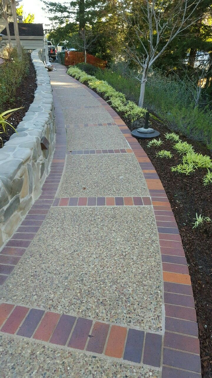Exposed Aggregate Walkway With Brick Dividers By Krcc
