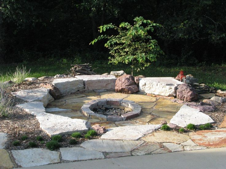 Idea - have the firepit come off from the poured portion of the patio slab.  Love the natural look for this - would lend itself perfectly to the long-term plans I have for the backyard garden...
