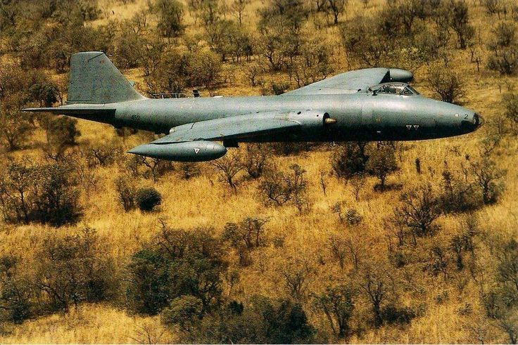 12 Sqn Canberra B(I)12 - 452 flying low level over Angolan bush.