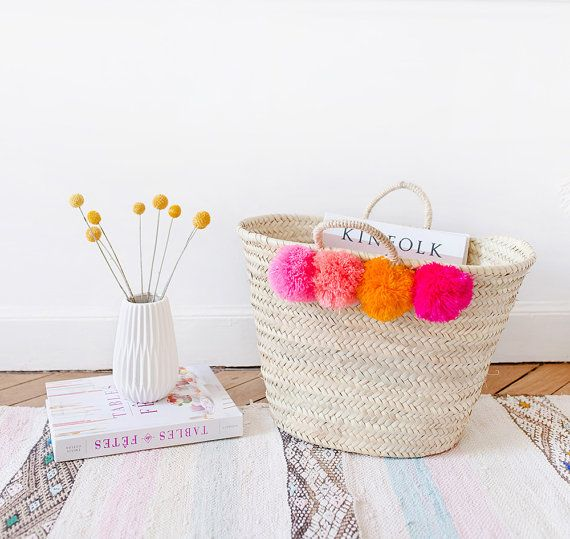 POM POM BASKET our handwoven baskets adorned with pom poms add a playful pop of color to any space.  size: 11 x 17.5 (because each basket is handmade, the sizes may vary slightly)  material: moroccan palm leaves + pom poms origin: handwoven by artisans in marrakech, morocco  ▲ GIVING BACK ▲ in partnership with the association tafarnout, proceeds from LOOM + FIELD support literacy education for women weavers and rural development projects in the demnate region of morocco. ----  LOOM + FIELD…