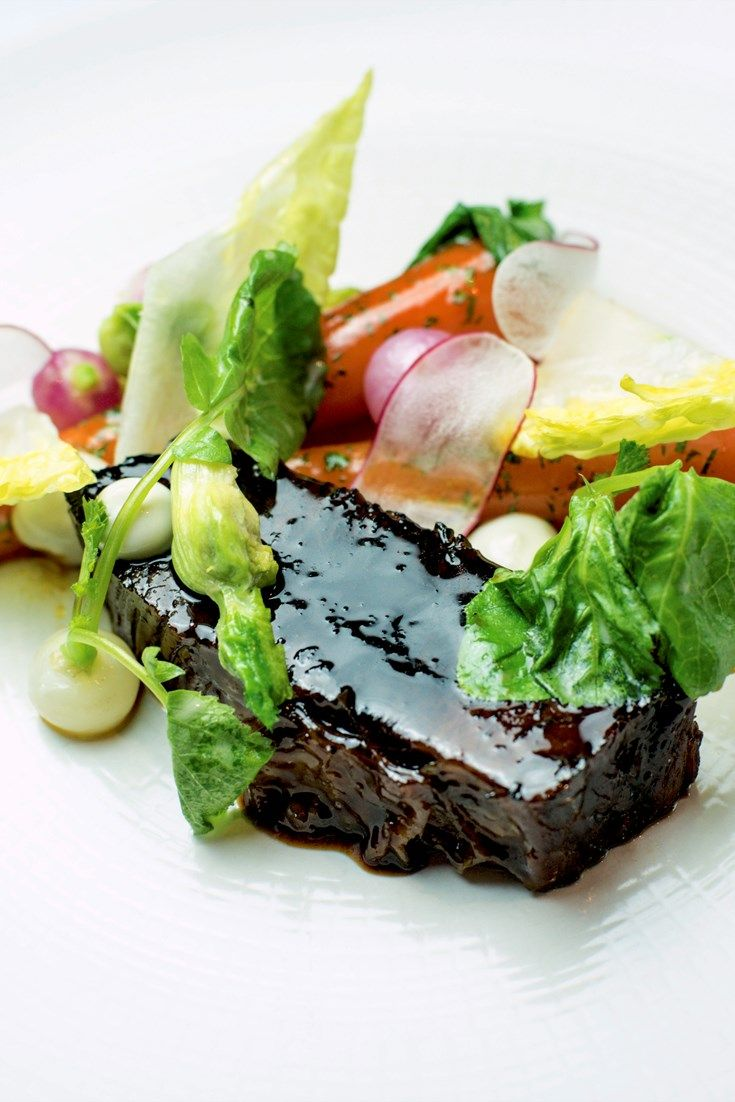 Chef Alyn Williams adds depth and sweetness to his beef brisket recipe with maple syrup, brining the meat and braising it slowly for super tender meat. Served with buttery vegetables and an oyster sauce recipe.