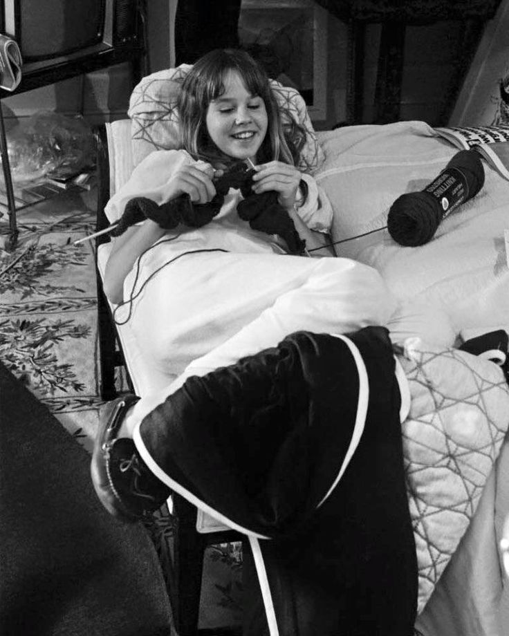 Linda Blair knitting in between takes on the set of The Exorcist.