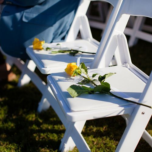 Real Weddings - In Bliss Weddings In remembrance of lost loved ones, yellow roses were placed on chairs during the ceremony. - See more at: http://inblissweddings.com/real-weddings/story/becky_and_scott/319#sthash.ljs3zs02.dpuf