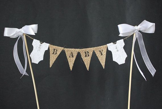 I have made this baby shower cake topper with white lace onesies and white ribbon trim just to play safe. Each little burlap/hessian flag or white lace