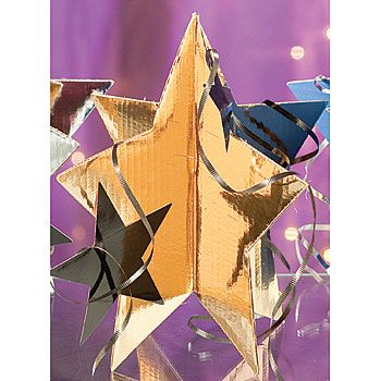 Add shimmer to your tables with this Gold 3-D Star Centerpiece. This 3-D cardboard star centerpiece is 13 inches tall and include smaller stars, curling ribbon and a larger 3-D star. $30/6