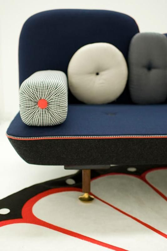 Moroso - Fantastic form and additional cushions, beautifully thorough piping and button detailing.