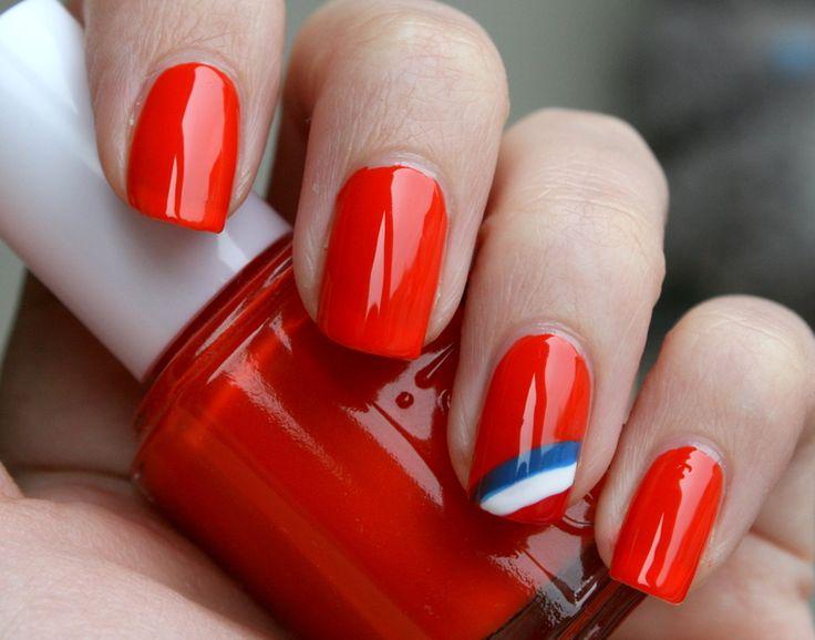 Deze knaloranje nagels zijn een met vlag en wimpel geslaagde look.