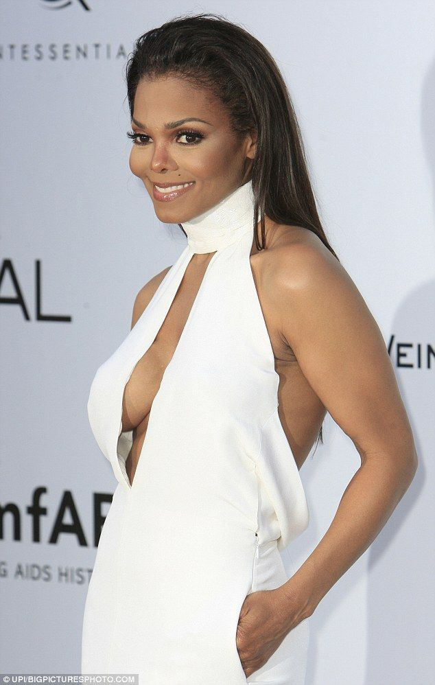 Janet Jackson shows off a bit too much cleavage alongside her dramatic weight loss in sexy plunging gown at amFAR event in Cannes