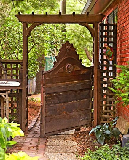 Create an unusual gate from an antique wooden headboard. Click for more garden gate ideas!