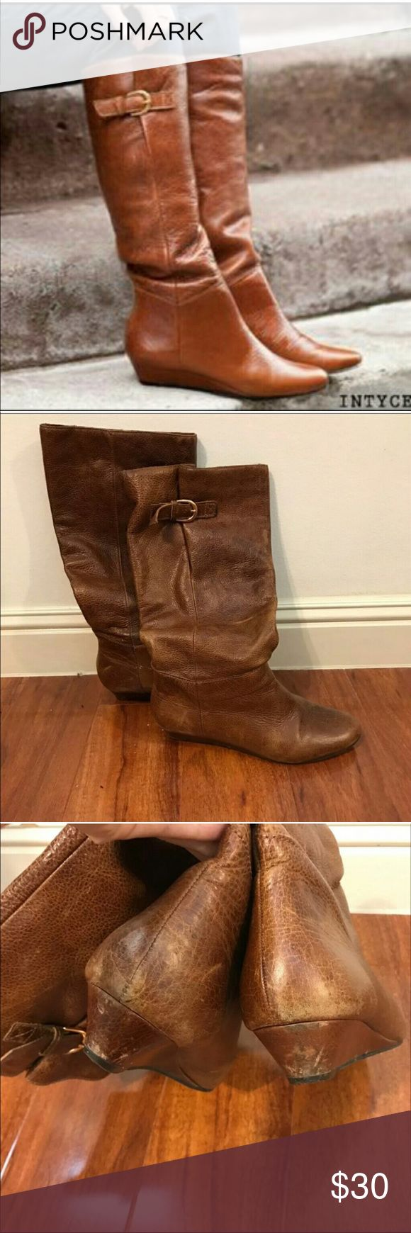 Steve Madden Intyce cognac leather boots Used Steve Madden boots, great condition. Size 8.5 slight lift in heel, not enough to call it a heeled boot, maybe a small wedge. Comfy.. able to tighten or loosen top of calf as well. Steve Madden Shoes Heeled Boots