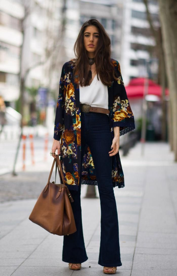 26 Ways to Style a Kimono for Spring - colorful kimono styled with belted high-waisted flares, a white blouse, and brown leather boho bag
