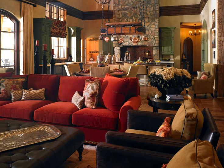 This Tuscan Style Great Room Has An Inviting Seating Area With A Tufted Leather Ottoman