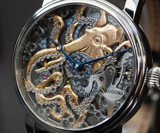Give your look some nautical flair by accenting it with this lovely octopus watch. Designed by master watchmaker Stefan Kudoke, this stunning 42mm skeleton frame watch displays an exquisitely intricate octopus intertwined along the watch's inner workings.