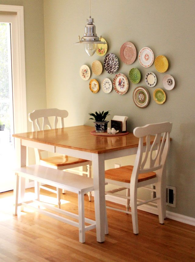 Table against the wall two chairs one bench seat Small dining room decor