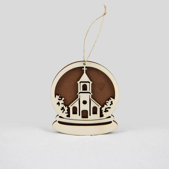 Wooden snow globe Christmas ornament with a church