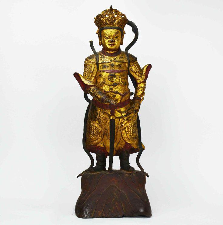 gardienne du temple en bronze doré