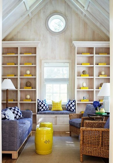 Tiny house living room with lots of shelving and seating.