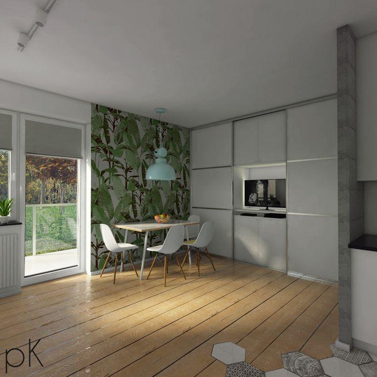 Koncepcja niedużego mieszkania dla młodych ludzi.... w celu zoptymalizowania przestrzeni, powstała pojemna szafa w której znalazło się miejsce na sprzęt RTV. Jasna drewniana podłoga salonu krzyżuje się z retro płytkami aneksu kuchennego. Całość utrzymana w szarościach wyjątek stanowi energiczny fragment ściany z żywą tapetą!