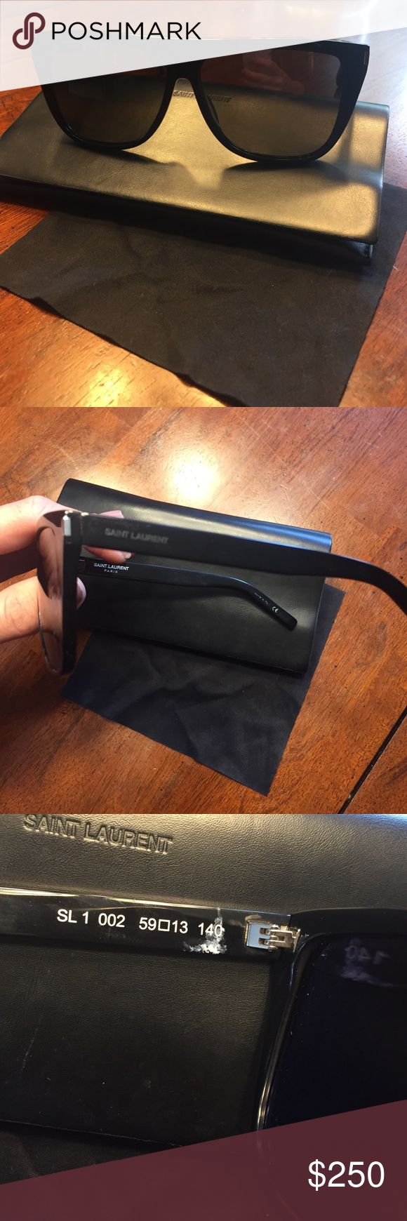 Saint Laurent SL1 002 Authentic Saint Laurent most popular sunglasses as seen on kim kardashian.  There is white on the inner arm not on outside idk what happened but does not affect the glasses and u cannot see when wearing them.  I purchased in april of 2016. Ⓜ️ better price Saint Laurent Accessories Sunglasses