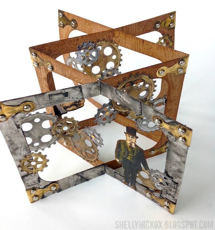 Hi all! Today, I'm sharing the tutorial for this cool, interactive steampunk card over at the Elizabeth Craft Designs blog. It's another version of the tunnel card I've been making by altering Karen B