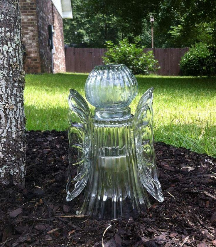 Make you own garden angel with a tall case, a globe vase, and 2 plates for the wings. Set over solar light stake.