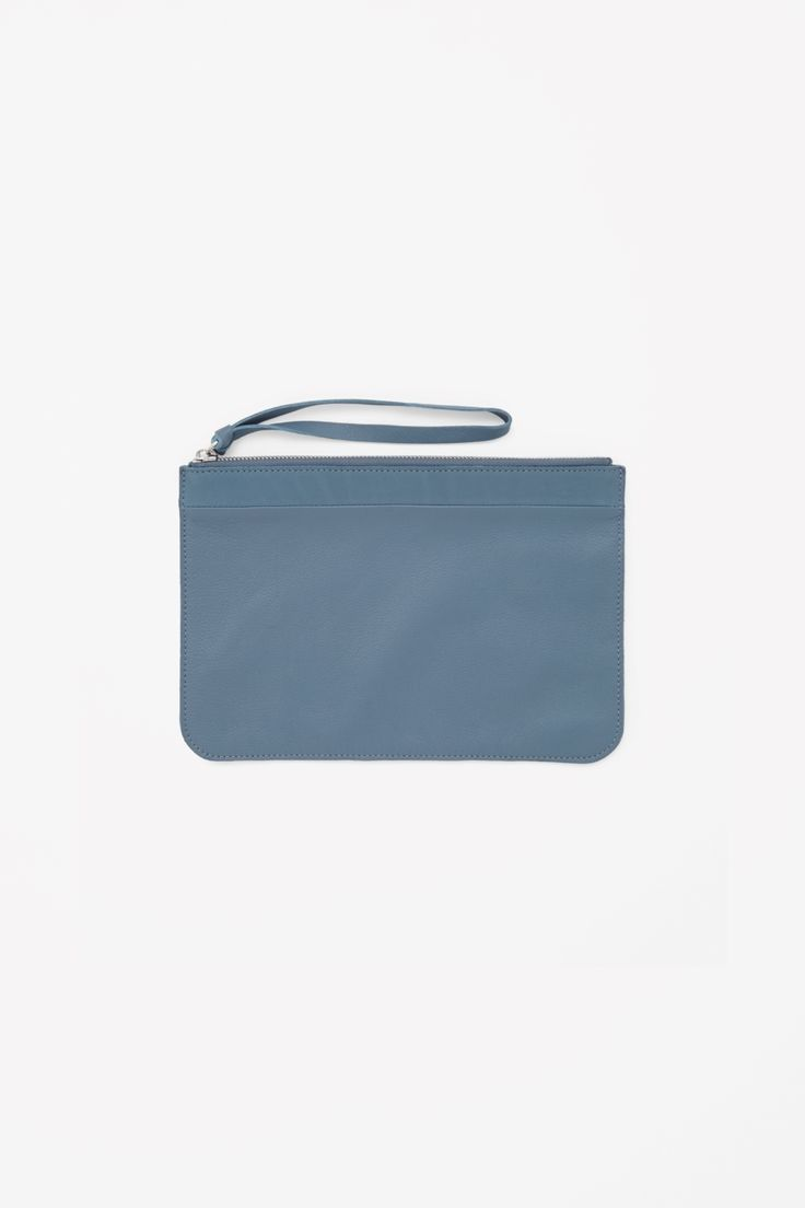 Made from leather with an embossed quality, this textured clutch has a metal zip fastening and raw-cut leather handle. Unlined, this versatile style can be worn as a clutch or to organise your belongings inside a larger bag.