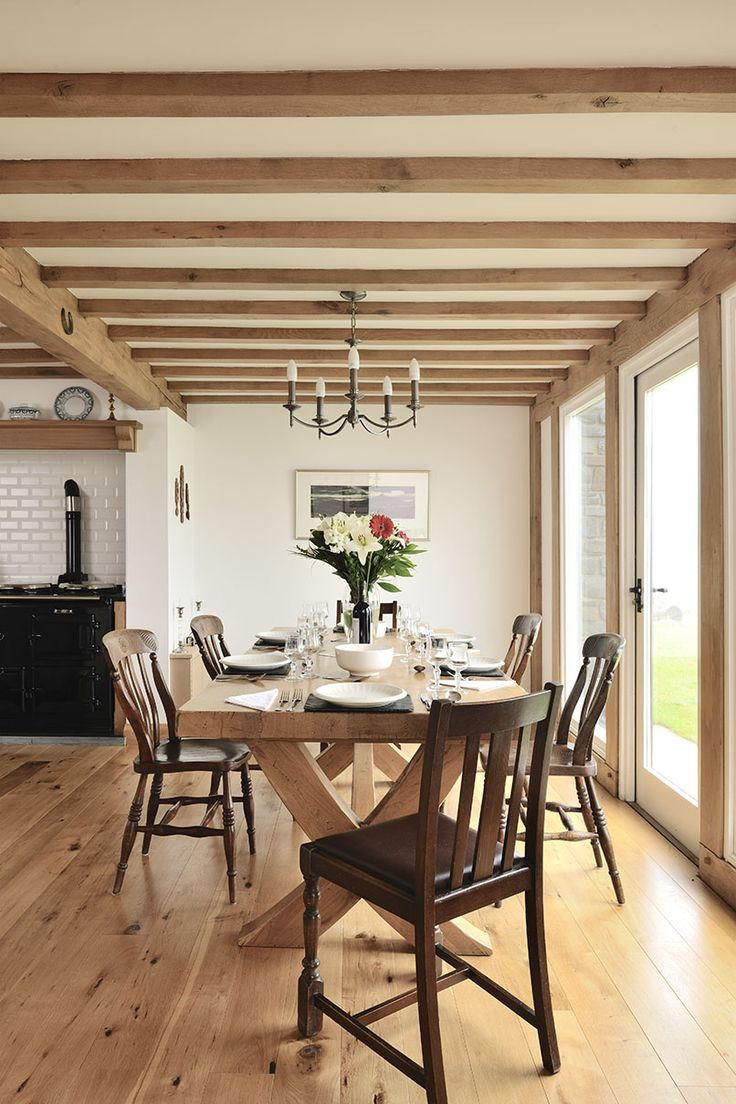 Flooded with light this large kitchen is a room for the family to spend time together.  #family #room #light #glazing #beams #oak #frame #welshoakframe #home #kitchen