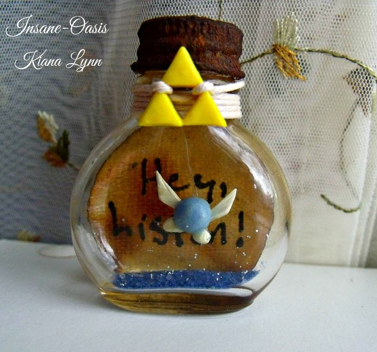 LoZ inspired Navi bottle charm. Navi and Triforce made from polymer clay.
