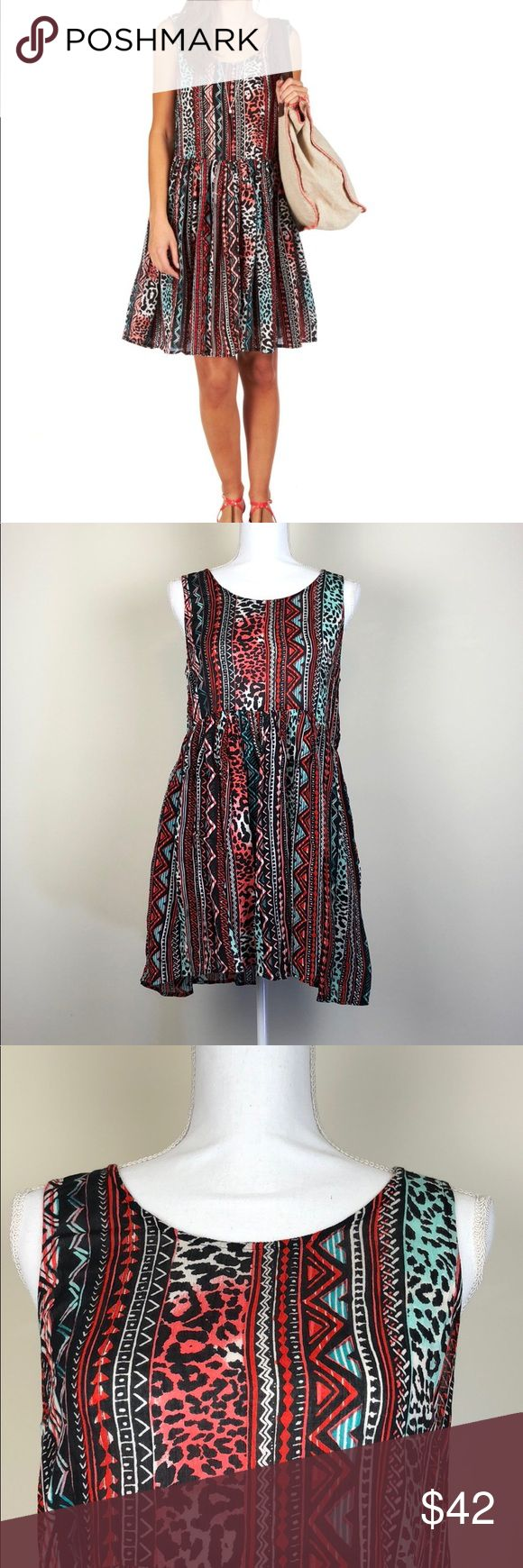 "Billabong Wild Chance Aquarius Dress Size Small New with Tags! Billabong Wild Chance Aquarius Dress. Size Small. Sleeveless smock style dress. Round neckline. Subtle pleating to skirt. Dipped back with fabric strip detail. Looser fit.   Approximate Measurements  Underarm to Underarm: 17.5"" Waist: 16.5"" Top to Bottom: 31.5""  I: 154 Billabong Dresses"